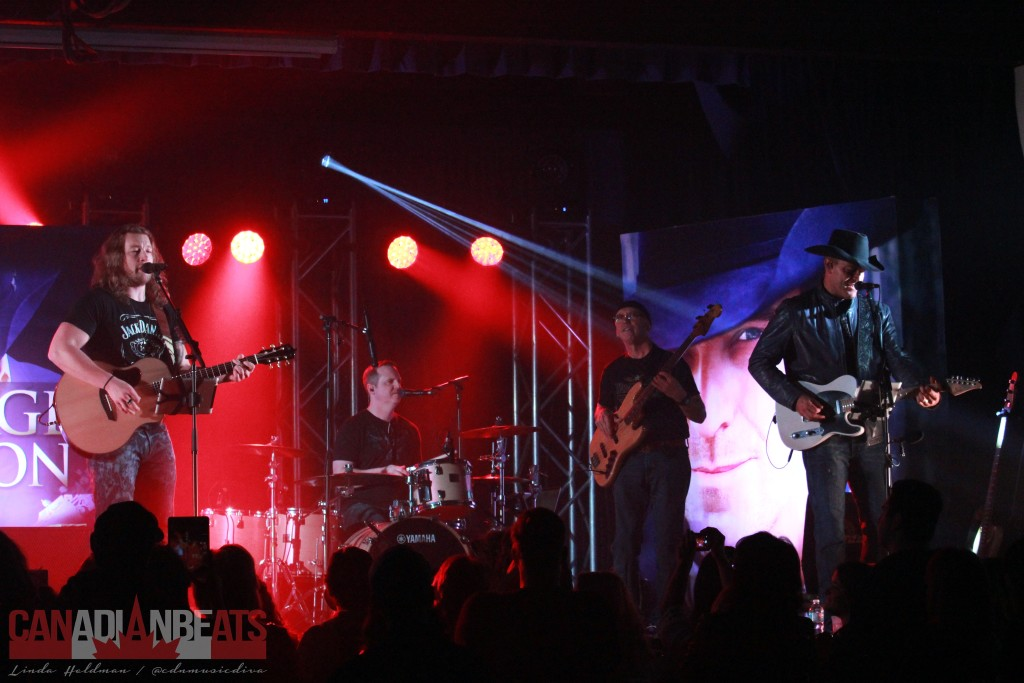 Cory Marquardt with George Canyon and band.