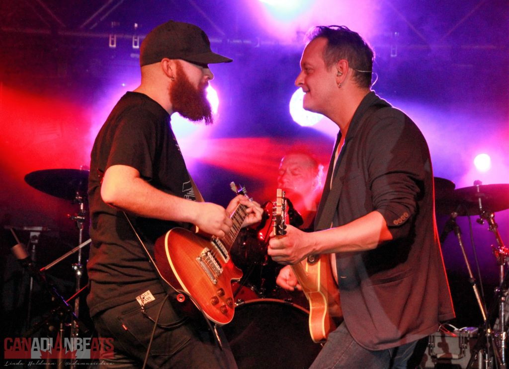 Guitarist from Chad Brownlee's band and David Caissy