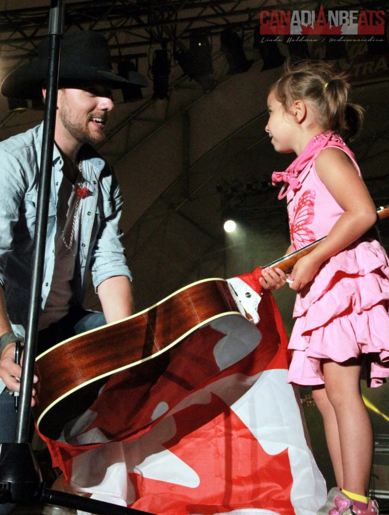 This little darlin' received a guitar from Brett Kissel